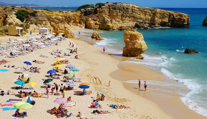 People enjoying the beach in summer