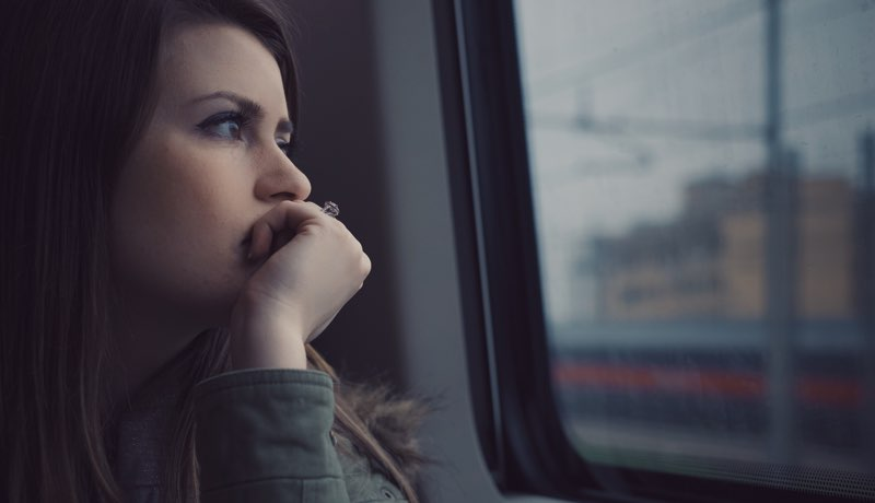 Picture of woman looking out of train window