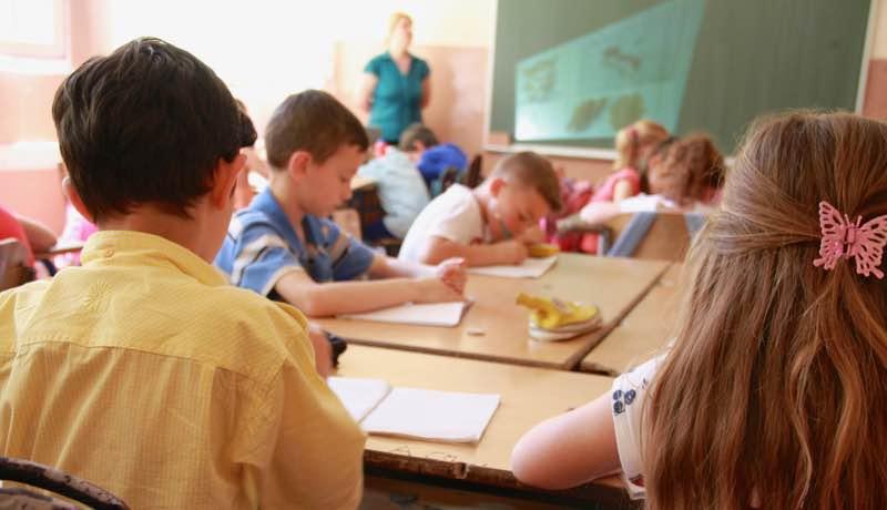 School children sat at desks and focused on their work